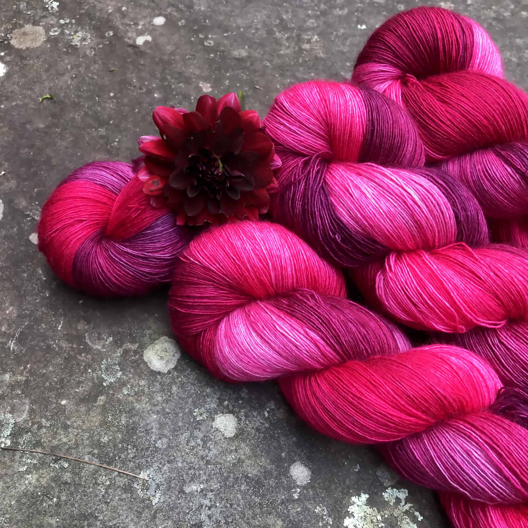 Hot pink and purple yarn with a pink flower.