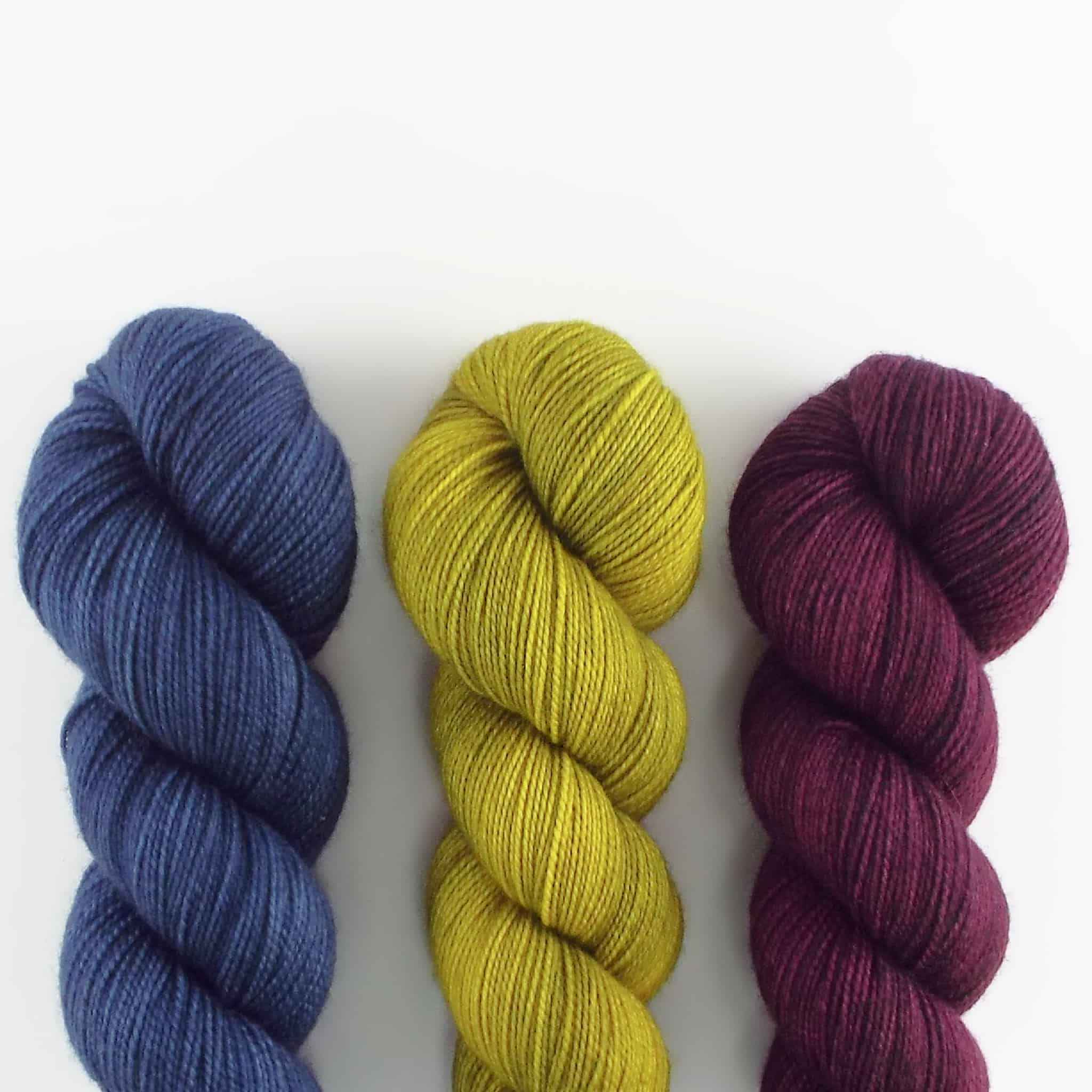 Blue, chartreuse and purple yarn.