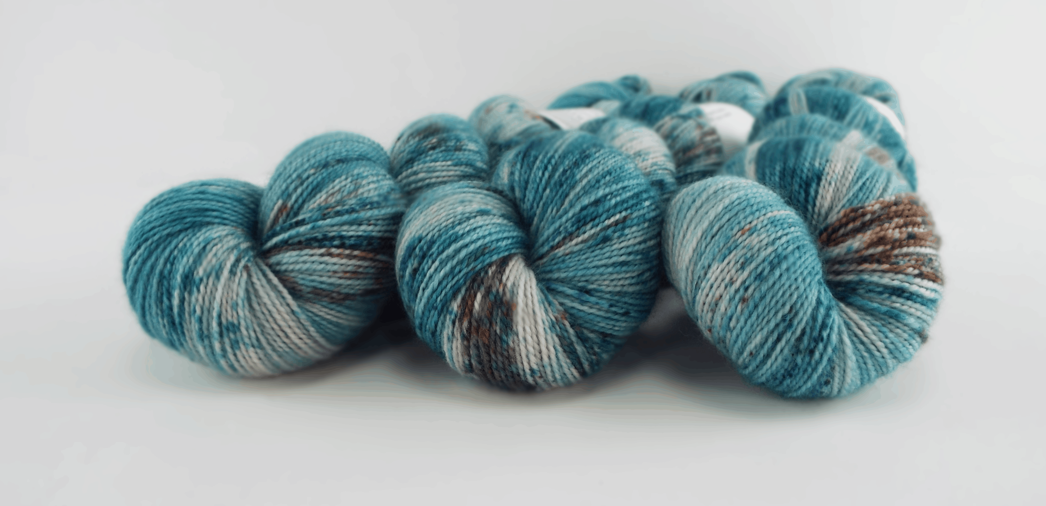 Blue yarn with gray speckles.
