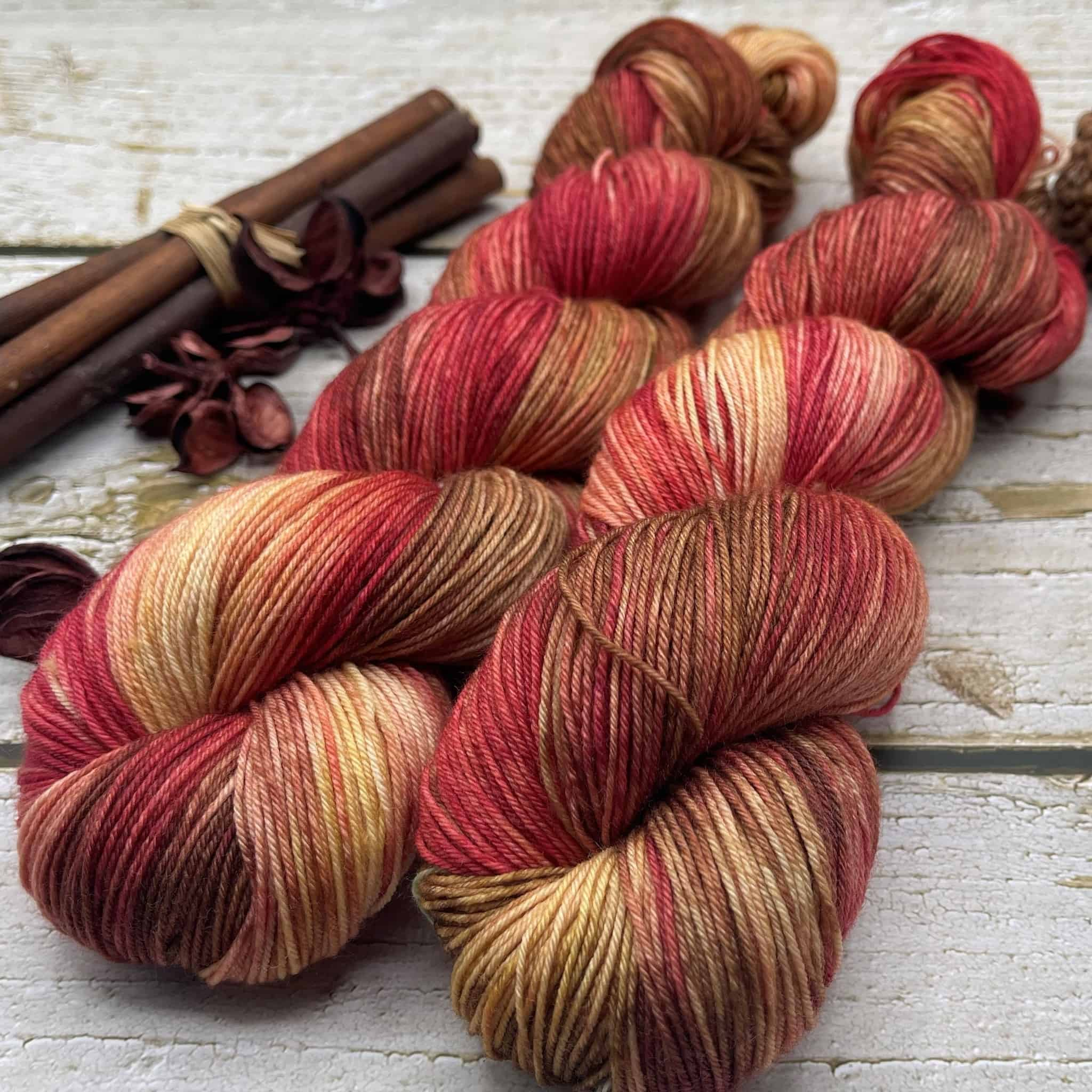 Yarn in red, orange and gold.
