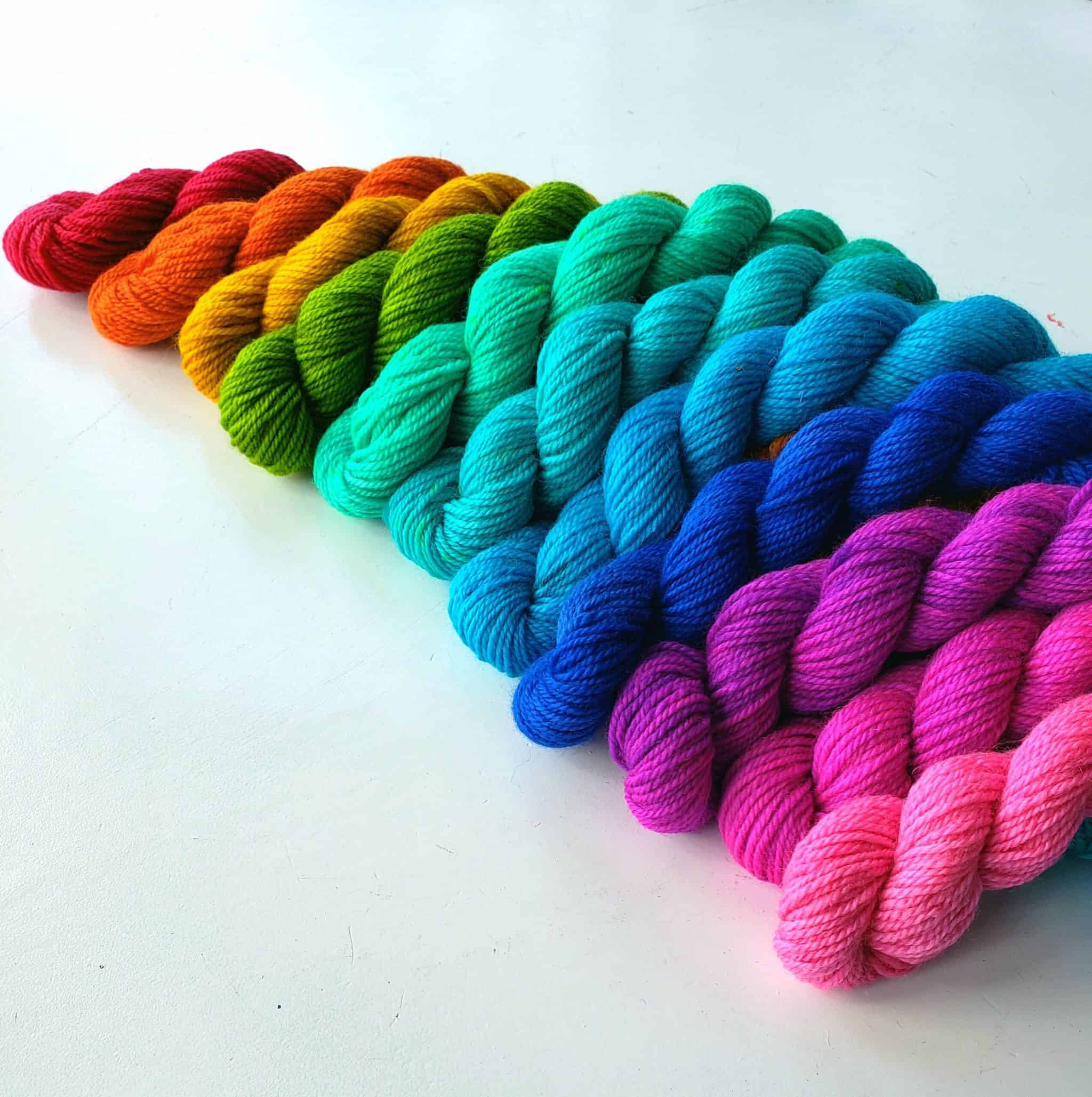 Skeins of yarn in a rainbow of colors.
