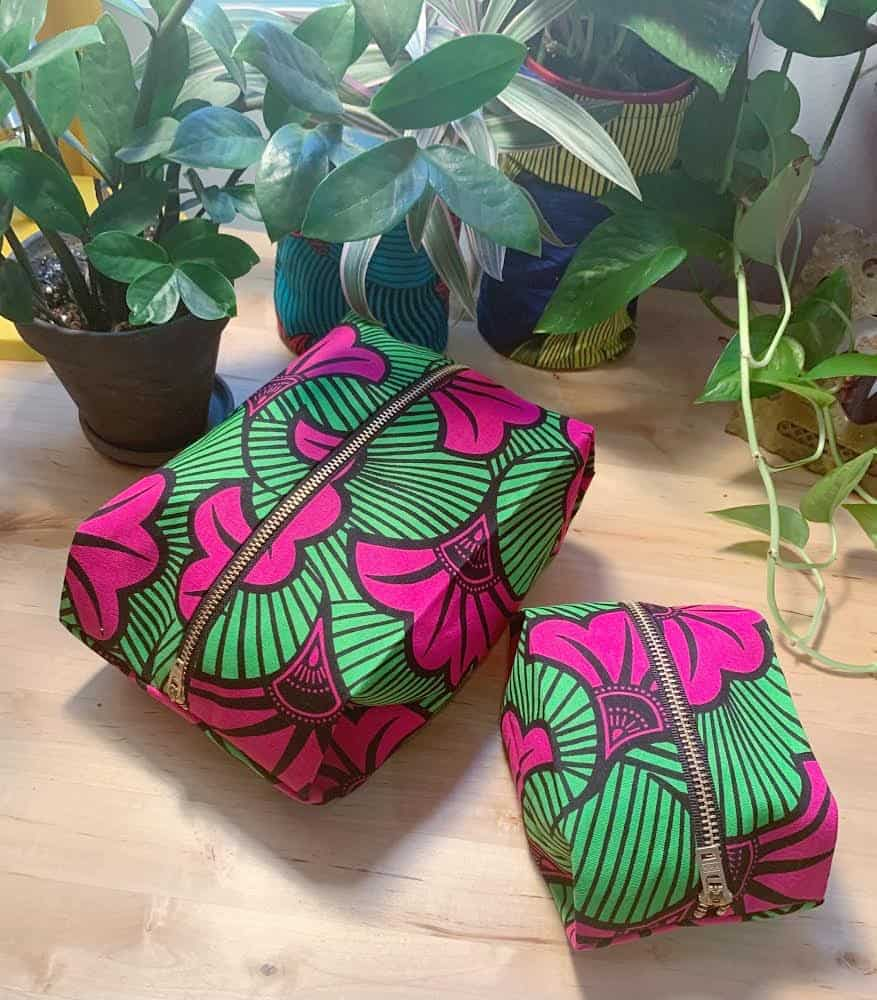 Box bags with a green and pink botanical print.