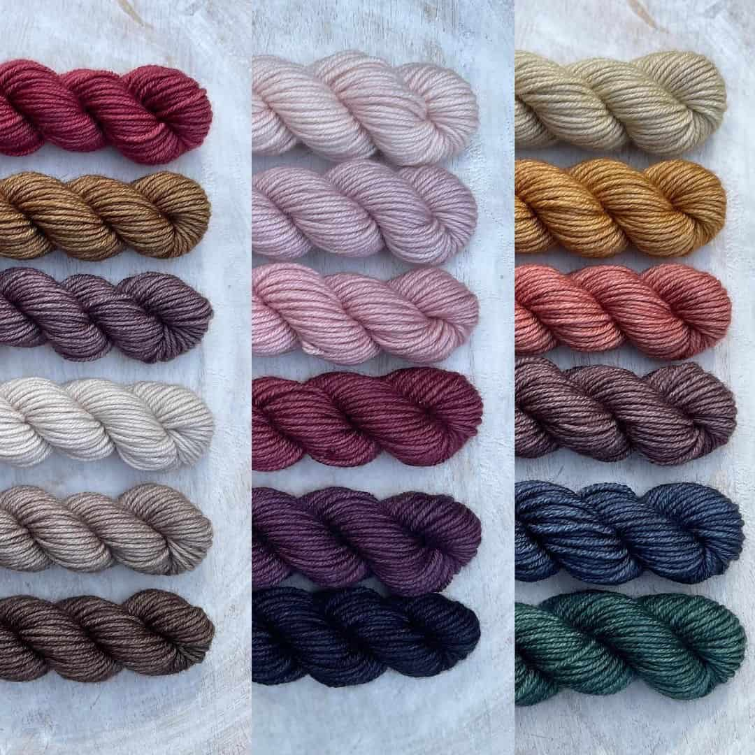 Sets of red, brown, purple and gray, pink, red and purple and gray gold, pink, purple, blue and green yarn.