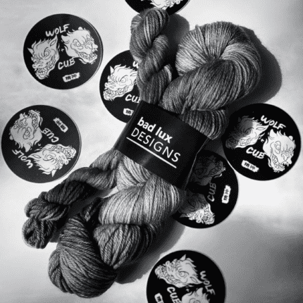 Yarn in black and white surrounded by stickers.