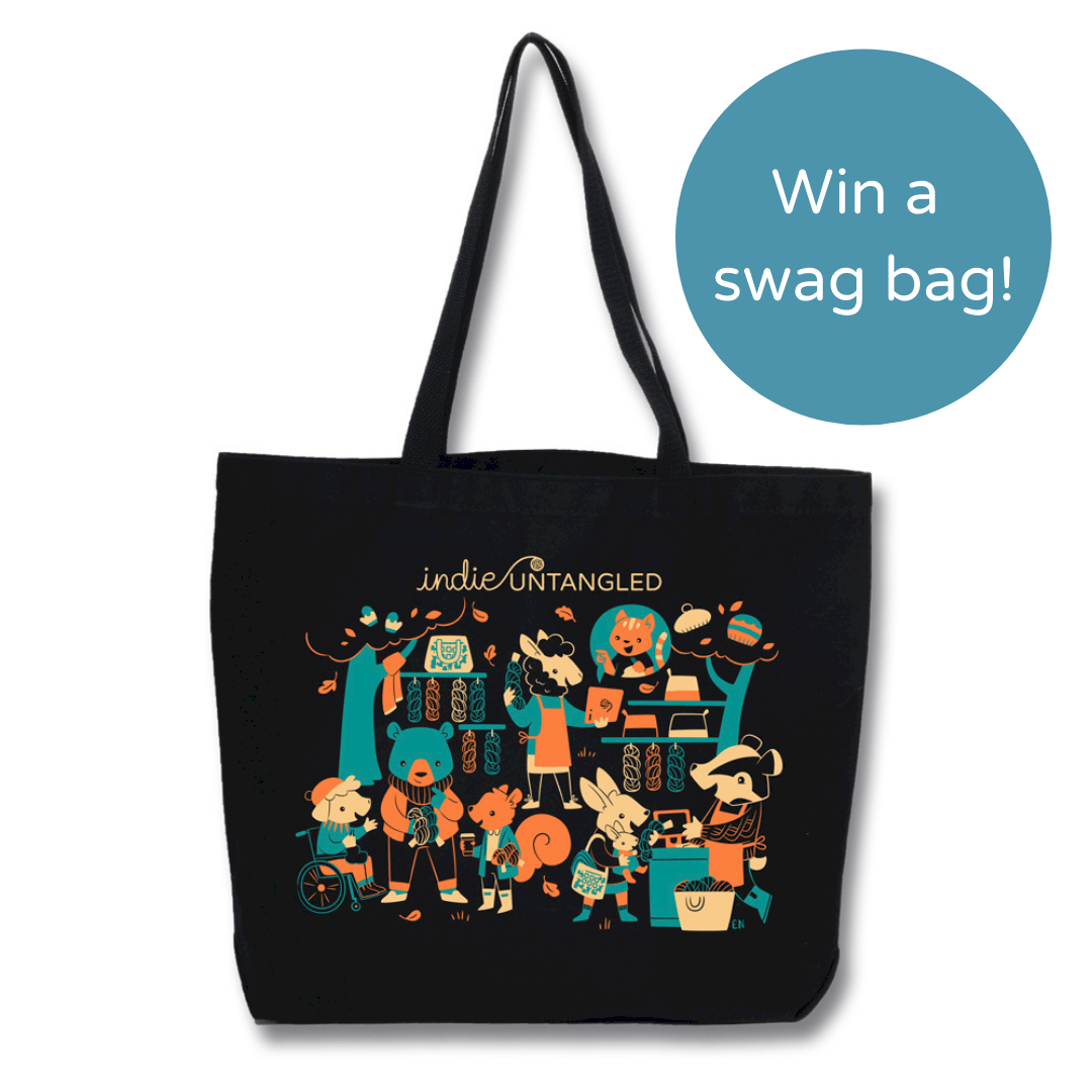 A black tote bag with a teal, orange and beige illustration of animals and the words Win a swag bag!